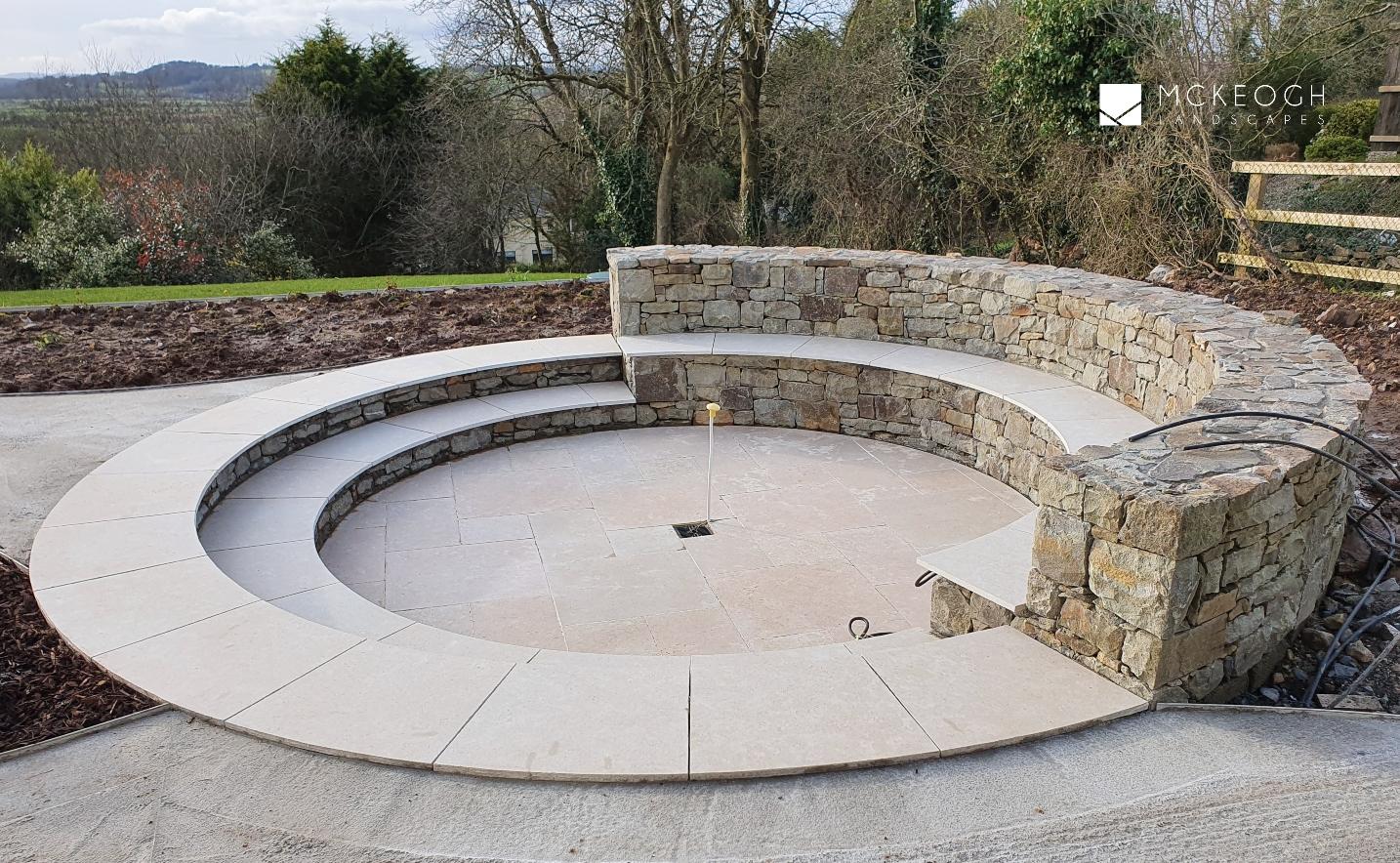 Circular sunken firepit and circular steps