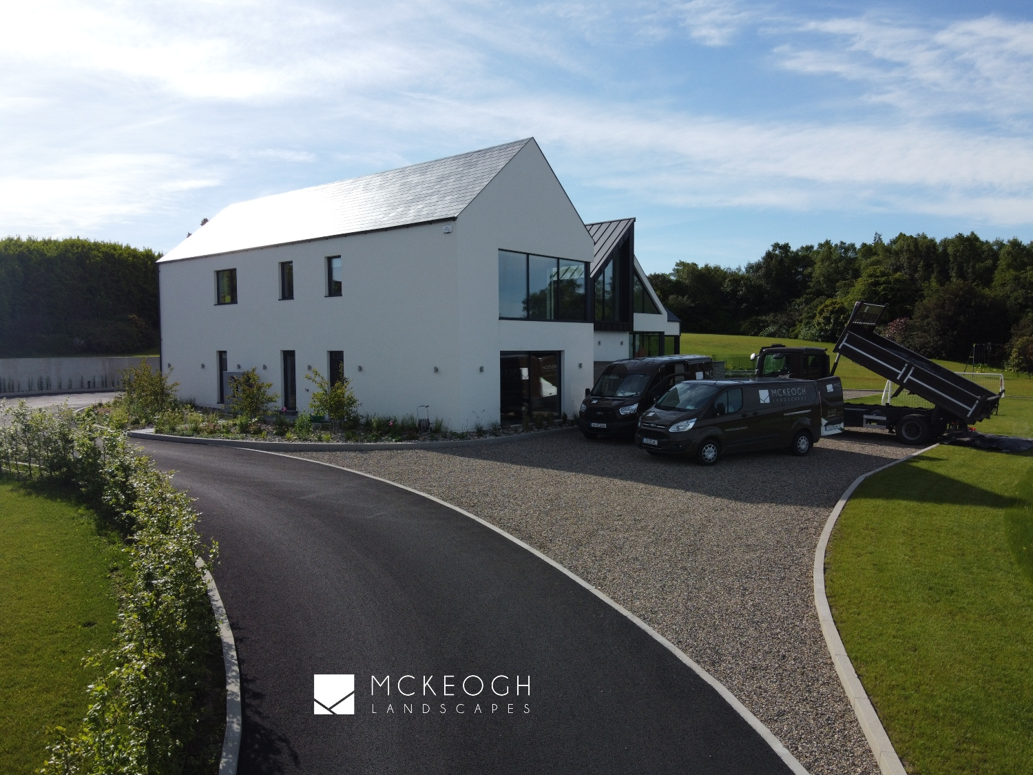 Using a mix of Tarmac and loose stone chips for this large driveway