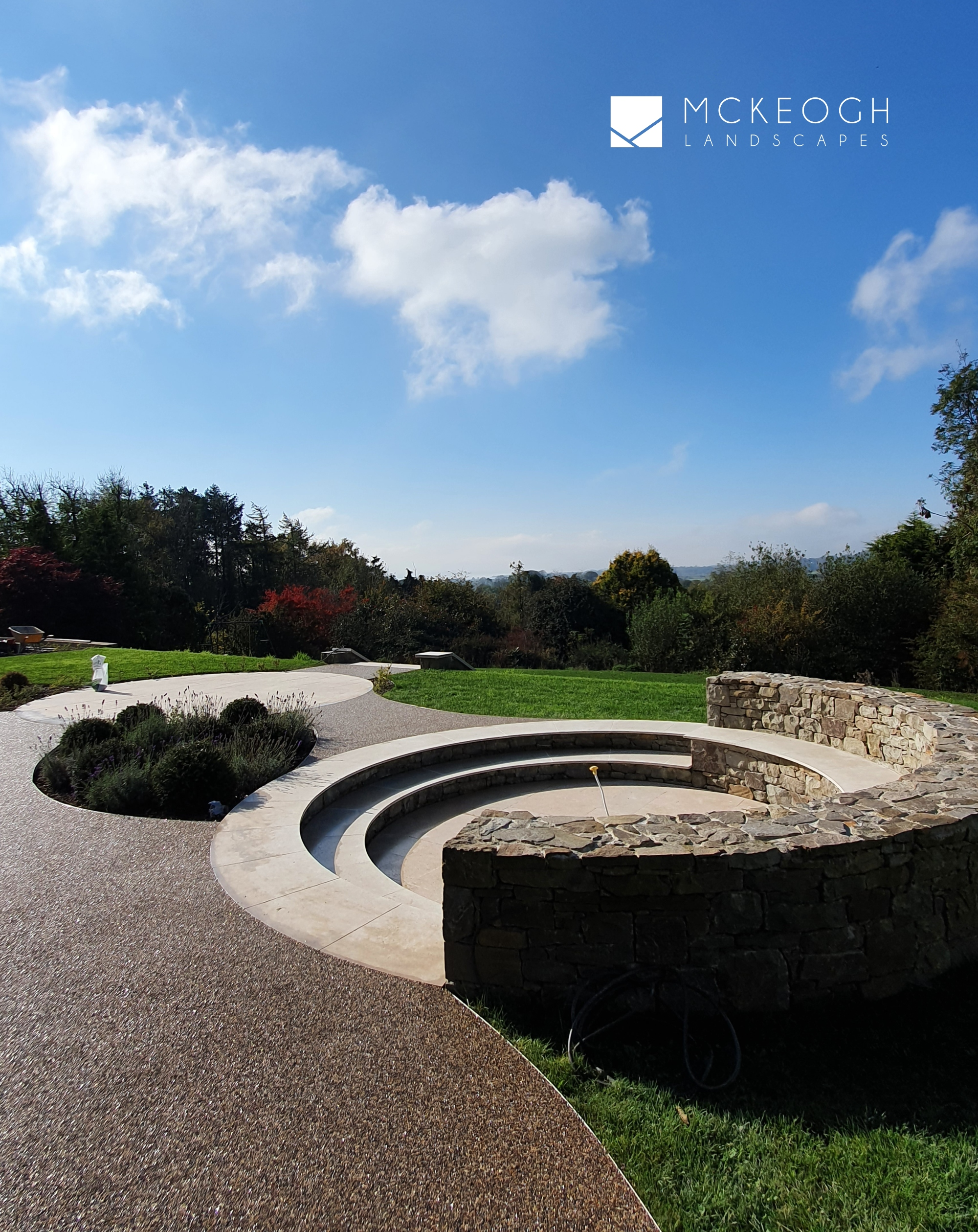 Circular sunken seating area using a mix of Egyptian Limestone, resin bound gravel and natural stone walls